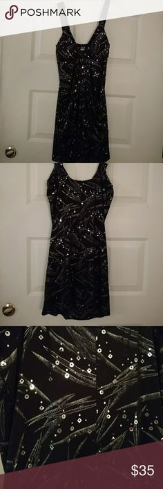 "Short prom or formal dress. Black cocktail dress knee-length, lightly padded cups, waterfall front from bust. Approx. 32"" from center of shoulder strap to hem. I am 5'3"" and it hits me 2 inches above my knees. Artisan sequins and metallic design print. There is a flounce of fabric below the waterfall that in 7 inches above the hem. Dress by Deb. Deb Dresses Mini"