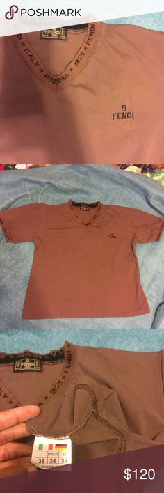 Authentic Fendi Top Comfortable Casual Fendi Top with Logo ribbing on arms & neckline ( 75% acrylic 25% polyester) Size is 38 Italy ..  Could fit a Small but ideally fits M/L ... Has lots of stretch. Good Condition. No Stains or markings Fendi Tops Tees - Short Sleeve