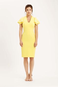 The Camden is a classic pencil dress with open ruffle sleeves and squared v-neckline. There is subtle satin detailing on the neckline and underneath the sleeve, colour matched to the crepe. Yellow
