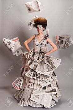 Portrait Of A Beautiful Girl In A Newspaper Dress Stock Photo, Picture And Royalty Free Image. Paper Fashion, Fashion Art, Fashion Models, Fashion Show, Fashion Outfits, Fashion Design, Recycled Dress, Recycled Clothing, Recycled Cans