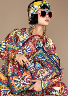 The colours and prints of the Sicilian Carts become fun accessories, gowns and sun dresses for a hot Italian summer. www.dolcegabbana.com ‪#‎DGSicilianCarretto‬
