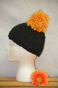 colors: black/gold style: fitted with pompom size: adult