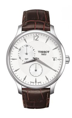 Tissot Tradition Quartz GMT The Tissot Tradition models are modern timepieces inspired by 1950s design. The vintage-style design is perfectly balanced with the classical details and subtle finishes such as guilloche decoration and a gently curved case. This particular model features a GMT function allowing a second time zone to be visible on the dial.