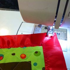 Adding finishing touches in a child's quilted blanket. Zig-Zag stitching and Mitered corners add a special touch & sturdiness for years of use.