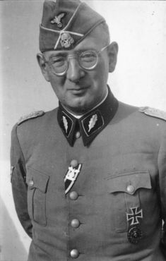 Portrait of Max Simon as SS-Standartenführer with medals; official portrait shot by the propaganda directorate of the SS, 1940.