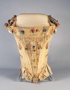 Bodice, France, 1770-1780. Cream pékin silk brocade with floral sprays, decorated with bobbin lace.