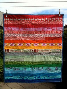 Happy stripes modern baby quilt. $60.00, via Etsy. • I like the diagonal quilting lines