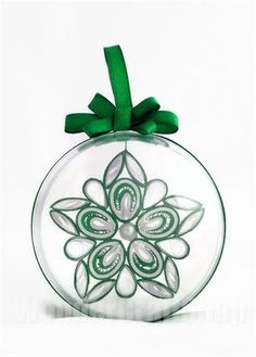 Please note that purchases made on or AFTER the 5th Dec MAY NOT arrive before Christmas Day.    The listing is for one made to order beautiful paper ornament in a transparent plastic sphere with a ribbon, ready for hanging on a Christmas tree. The ornament will have a ribbon attached with loose ends so that you can make a knot at the lenght that suits YOU best.  You may want to hang it on a Christmas tree or on an ornament stand or by the window.    WHATS INSIDE?   Beautiful Christmas Star…