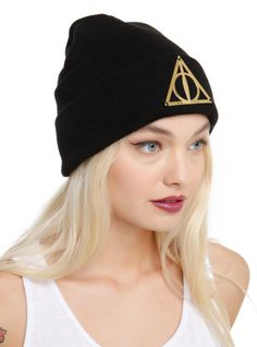 Black knit beanie with a gold tone metal Deathly Hallows symbol.