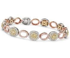 This bracelet features fancy yellow and white diamonds adorned by oval halos of brilliant round diamonds | Holiday Gift Guide