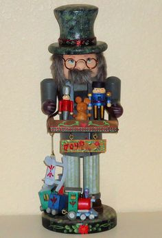 Decorative painting: A Beautifully handpainted tole, wooden nutcracker, Toy Maker figure selling dolls, trains, and hobby horses. $75 at http://www.visualgemsstudio.com