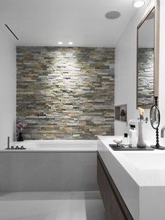 Stone Accent wall in your #Bathroom. Something to look at in the Tub! http://www.remodelworks.com/ More More