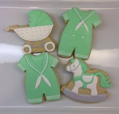 Green and white baby onesie, rocking horse and stroller cookies