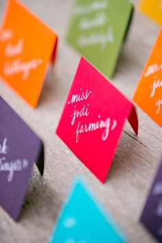 rainbow place cards #rainbowwedding #weddingchicks http://www.weddingchicks.com/2013/12/26/a-rainbow-wedding/