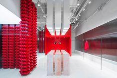 Scarlet thread and sheets of steel make an unconventional pairing inside this store in Chongqing, which Joy Season Studio has created for Annakiki. Pierre Marie, Stone Pillars, Steel Columns, Textures And Tones, Merchandising Displays, Retail Space, Design Studio, Pink Stone, Retail Design