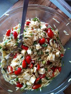 Caprese Orzo Salad:  1/4 cup red wine vinegar  1 teaspoon honey  1/2 cup olive oil  1 pound orzo  1 pint small cherry tomatoes, halved  1 bunch green onions, chopped  1 cup chopped fresh basil  1 7-ounce container feta cheese, cut in to 1/4-inch cubes  salt & pepper to taste