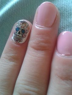 Pink nails with skull on white