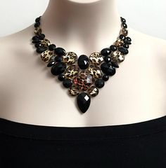 A personal favorite from my Etsy shop https://www.etsy.com/listing/210745344/leopard-bib-necklace-leopard-and-jet
