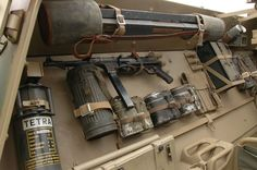 A Hanomag SdKfz 250/1 halftrack interior showing weapons and material storage