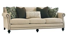 """The """"Brae"""" sofa from #Berhardt combines style and comfort in one package. Stylish nail head trim is featured on the arms, footboard, and back, multiple accent pillows add flare to the neutral base cloth making it a very versatile piece. Kiln Dried Hardwood frame and Down seats standard. Available in fabric or Leather. Proudly made in North Carolina."""