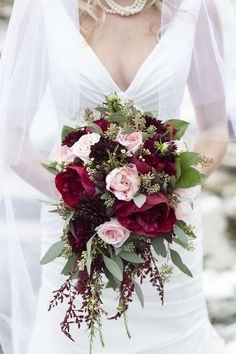 This bouquet is classic and incorporates small pops of pale pink and muted green along with marsala.   via Melanie Bennett Photography