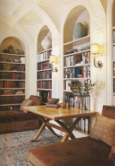 arched bookcases set into the wall