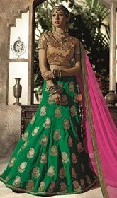 Green Color Silk Embroidered Lahenga Choli #lehengacholisale #lehengacholionlineshopping Real elegance comes out with this green color silk embroidered lahenga choli. Look ravishing clad in saree which is enhanced lace, resham and stones work. Upon request we can make round front/back neck and short 6 inches sleeves regular lehenga blouse also.  USD $ 283 (Around £ 195 & Euro 215)
