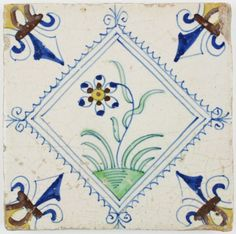 Antique Dutch Delft tile depicting a wonderful flower in a 'stamp' inpired diamond square, 17th century