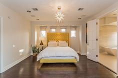 Rich hardwood flooring and an en suite bathroom offer a great space for this master suite. 6136 W. 5th St | Beverly Grove