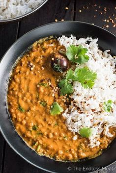 This easy to make Creamy Coconut Lentil Curry takes less than an hour to make (mostly hands off time) and is packed full of delicious Indian flavors. It's a healthy vegan recipe that makes a perfect meatless Monday dinner recipe. Make extras and you'll have a giant smile on your face at lunch the next day. | theendlessmeal.com #indianvegetarianrecipes
