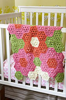 This flower throw is the perfect size for newborns and infants. (Lion Brand Yarn)