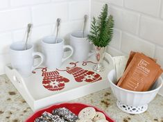 A DIY stenciled wooden tray for a hot cocoa bar using the Mittens Craft Stencil from Cutting Edge Stencils. http://www.cuttingedgestencils.com/mittens-holiday-decor-stencils-for-diy-crafts.html