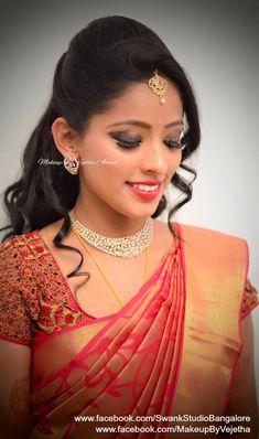 Close-up of Akhila's bridal makeover for her reception. Makeup and hairstyle by Vejetha for Swank Studio. Photo credit: Manish Ananda. Pink lips. Glitter smokey eye makeup. Bridal jewelry. Bridal hair. Silk sari. Bridal Saree Blouse Design. Indian Bridal Makeup. Indian Bride. Diamond Jewellery. Statement Blouse. Tamil bride. Telugu bride. Kannada bride. Hindu bride. Malayalee bride. Find us at https://www.facebook.com/SwankStudioBangalore