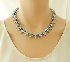 Silver and blue chain maille star necklace.