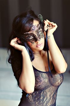 Again, this shoot got it right. Love the black mesh neglige and mask. Her hair and make-up rock too.