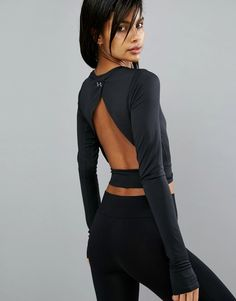 Buy it now. Under Armour Crop Top With Open Back - Black. Top by Under Armour, Super-soft moisture-managing jersey, Designed to keep you cool and dry, Round neck, Thumb-hole cuffs conform to your hand muscles, Open cross-over back, Slim fit - cut close to
