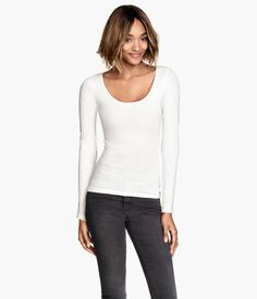 Figure-fit top in soft stretch jersey with a wide neckline and long sleeves.