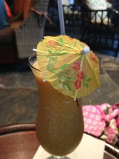 Polynesian Resort Tambu Lounge Island Sunset - Seven Tiki Spiced Rum, PARROT BAY Coconut Rum, Melon and Peach combined with our Guava-Passion Fruit Juice