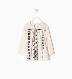 Image 1 of Oversized blouse with border detail from Zara