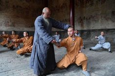 Monks practice martial arts at Shaolin Temple in central China's Henan Province