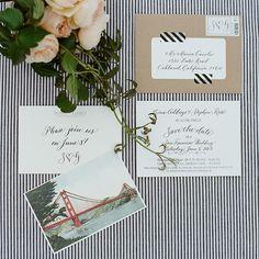 Black, white invites with kraft paper envelopes and stripes washi tape