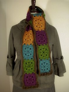 An Autumn Gem version of the Citrus Harvest Scarf. I used good quality soft acrylic yarn using colors chosen by the customer. MEMBER - Adornada