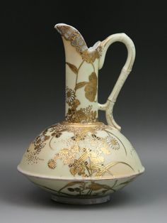 Japanese Satsuma Gilt Moriage Porcelain Pitcher    Sign In to see what this sold for  Rare Japanese Satsuma Gilt Moriage Porcelain Pitcher: finely painted on the globular body and tall slender cylindrical neck with heavily gilt flowers and vines: with tall C-scroll handle and V-shaped spout: three character blue sign on the base: Circa 1900