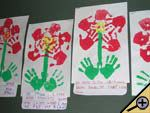 """May Flowers Bulletin Board - Students can create fun """"flowers"""" using their hand prints. http://bulletinboards.theteacherscorner.net/monthly/may/"""