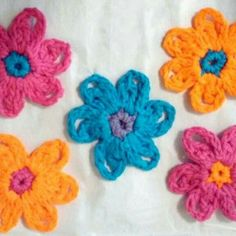 Vibrant colored crocheted flower appliques will brighten your day!