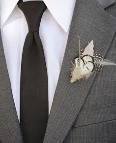feather boutonniere | Edyta Szyszlo Photography | blog.theknot.com