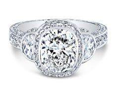 Jack Kelege platinum diamond engagement ring. A modern masterpiece, this ring features fancy diamonds in the halo, two half-moon shaped diam...