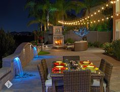 Full backyard remodel including paver patio, paver sitting wall, dual led water feature, built in fireplace, built in kitchen, pergola, bbq island and outdoor lighting.
