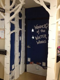 """Wonders of the Winter Woods"" classroom door - students created woodland animals and wrote descriptive sentences. We read The Big Snow, and are going to tie in Owl Moon as well."