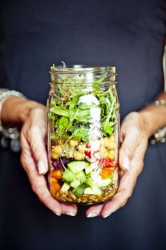 Salad in a jar. I just don't get it.  Yeah, it looks cute but what do you do with it?